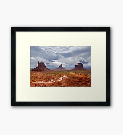 Storm clouds clear over Monument Valley Framed Print