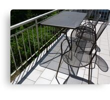 Table and chairs in metal Canvas Print
