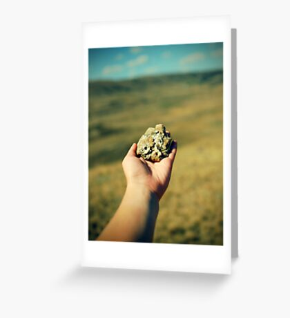hand with a stone Greeting Card