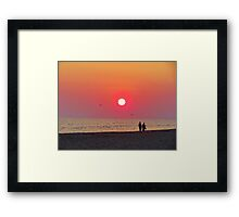 Couple Watching the Sunset Framed Print