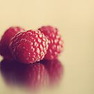 Summer Kissed Raspberries by ameliakayphotog