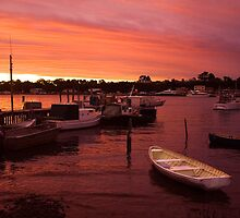 A white boat at sunset, Strahan, Tasmania by Elana Bailey