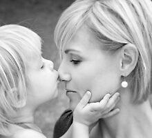 Kisses... by Nicole Goggins