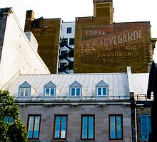 Old publicity in Old Montreal by Sylvain Dumas