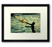 catching fish Framed Print