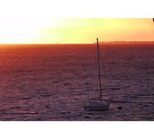 A sailboat at Sunset Photographic Print