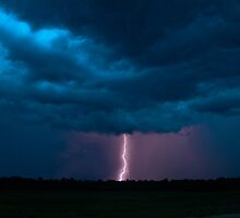 Lightning beyond the field. by Brett Wicker