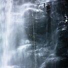 Waterfall abseil by Alexander Kok