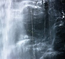 Waterfall abseil by Alexander Kok