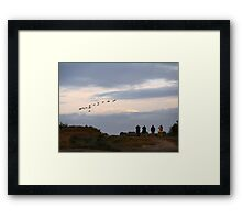 Commuter watching Framed Print