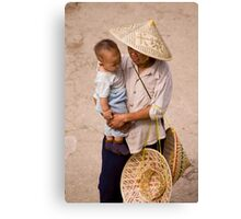 Hat Lady And Infant Canvas Print