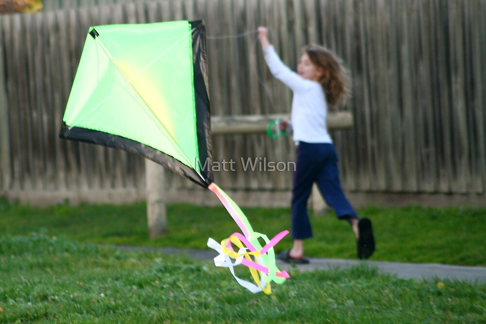 Doing her best to make it fly, No wind this day! by Matt Wilson