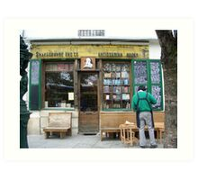 Carpenter outside Shakespeare and Co. book shop - Paris Art Print