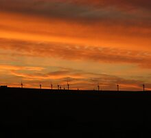 Sunset over windfarm - Ogden, Halifax, UK by Andy Beattie
