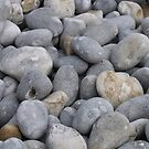 Pebbles on the beach by Inquisitive4now