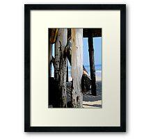Worn Piers Framed Print