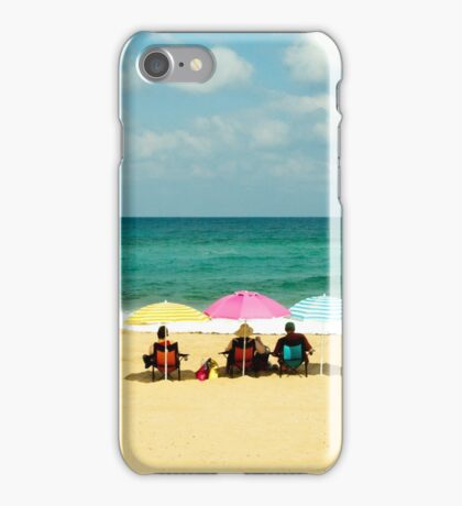 Three umbrella on a lonely sea beach iPhone Case/Skin
