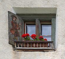 Decorated Window and Geraniums by Yair Karelic