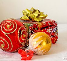 Red  Christmas ball, gold ball and brightly wrapped packed in red foil by pogomcl