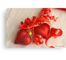 Two red satin glass heart ornaments on white damask with red ribbon Canvas Print