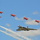 The Red Arrows with Avro Vulcan XH558 by mike  jordan.