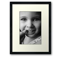 Child's pretty face Framed Print
