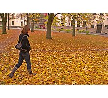 Girl walking among autumn leaves Photographic Print