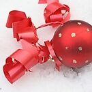 Red Christmas ball on snow by pogomcl