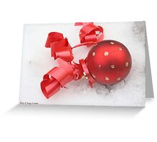 Red Christmas ball on snow Greeting Card
