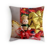 Toy soldier with an accordian  stands before a gaily wrapped  Christmas package in red foil Throw Pillow