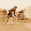 Two Cyclists Battling for the Lead - Sepia Tones by Buckwhite