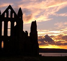 Sunset over Whitby Abbey, Whitby, N. Yorkshire by Gordon Hewstone