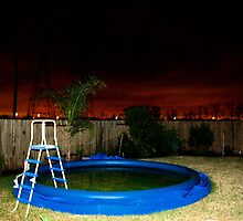 A Deflated Pool in a Suburban Back Yard by amdrecun