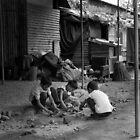 Children at play, Lainchaur. Kathmandu by John Callaway