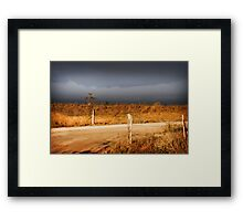 STORM CLOUDS AND RUSTY WIRE Framed Print