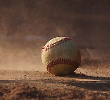 Baseball on home plate by agenttomcat