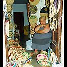 A woman behind weaving baskets  by Ferdinand Lucino