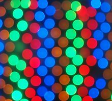 Defocused and blurry image of multicolored lights by vladromensky
