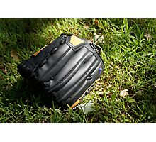 Baseball glove in the grass Photographic Print