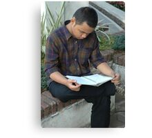 reading a book Canvas Print