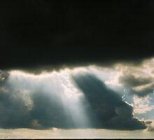 Rays of Light Through Dark Clouds by wamiqansari