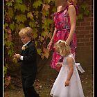 Small wedding party goers by Odille Esmonde-Morgan