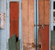 Faces on the blue door by Syd Winer