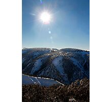 Sun on the mountainside in winter Photographic Print