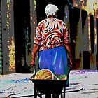 woman with a wheelbarrow in the street by spetenfia