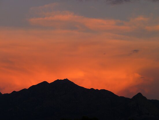 Red Glow Behind the Santa Rita Mountain Range by Lucinda Walter