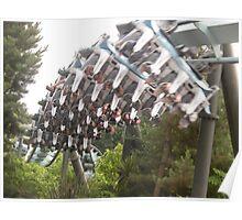 Theme park ride speeding past Poster