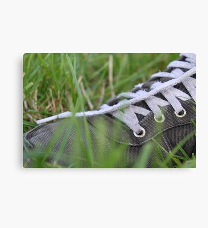 Nike Trainer In Lush Green Grass Canvas Print