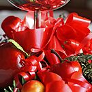 Reflection  of a silver goblet  with  a candle apples  and greens by pogomcl