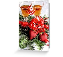 Two fluted wineglasses  stand amongst yew with two crimson  hearts A Greeting Card